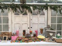 Wedding dessert lolly buffet with timber door backdrop