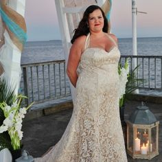 Champagne colored lace wedding dresses have an evening time feeling.  This plus size bride chose a halter style wedding dress.  We can recreate this style & look for you.  We are based in the USA and offer curvy brides from all over the globe affordable custom #plussizeweddingdresses & replica designs they can afford.  Pricing can be obtained when you contact us directly.