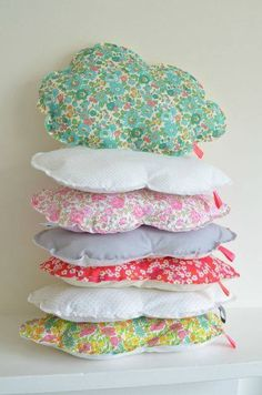 I'm in LOVE with these little cloud pillows. Just some fabric from either old dresses or clothes, Or buy some and stuff with stuffing cotton from an art supply store. I might make myself a few!!!