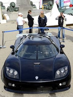 AUTOMOTIVE MARVEL : People look at the Koenigsegg CCX on display during the Stockholm Car Festival at Kungstradgarden. The festival is Sweden's first outdoor car saloon which takes place from September 21 to 23. (AFP)