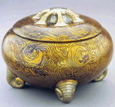Lidded container - Zsolnay Manufactory (1853-2001), Hungary - This with snail-shaped feet, 1912-13, is decorated with the shimmering eosin glazes designed to compete with contemporary French luster ceramics and American Tiffany glass.