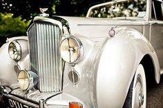 How about a vintage Rolls Royce to whisk you away from the ceremony? Yes please!  | Photo by JAGstudios