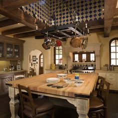 Use of tile in the ceiling treatment adds color and character to the space.  Spanish Colonial Hacienda - mediterranean - kitchen - san francisco - John Malick & Associates