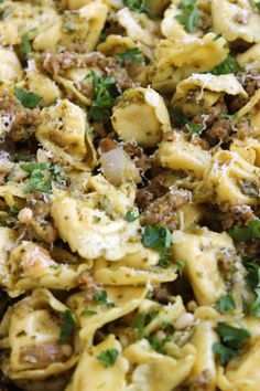 Cheese Tortellini tossed with Italian sausage, pesto and pine nuts make a flavorful and quick dinner. One skillet cooking makes clean up a breeze. pasta sausage Skillet Tortellini with Sausage and Pesto - The Suburban Soapbox Pesto Tortellini, Sausage Tortellini, Pasta Recipes, Dinner Recipes, Cooking Recipes, Cheese Tortellini Recipes, Budget Cooking, Oven Recipes, Easy Cooking