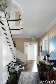 Classical architectural details in the entry set the tone for the rest of the house. James Merrell  - HouseBeautiful.com