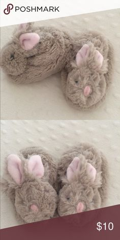 Pottery barn baby bunny slippers So adorable!  Baby slippers, cozy and soft with little bunny faces.  Bought at pottery barn kids.  They are don't have a size on them, approx 5 inches. Pottery barn kids Shoes Slippers