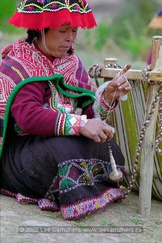 Peruvian weaver, spinning on a drop spindle.