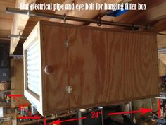 Shop made Air Filtration system uses a blower motor from a downdraft cooktop and eye bolts and emt conduit to hang it - by Cruiszr on Lumberjocks