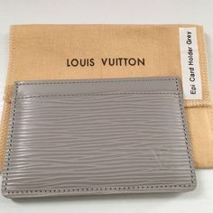 Louis Vuitton Epi Cardholder. Authentic. Epi cardholder in light gray with yellow interior. Has three card slots. Made in France item. Very good condition. All stitching is intact and in excellent condition. The interior leather is excellent. There is one scratch on the back left corner only visible if you are looking for it. See picture for details. Comes with original receipt from the King of Prussia LV store, sku card, dust bag, and box. I am the only owner.  Model number: M60328. Louis…