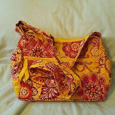 Retired Vera Bradley bag Bali Gold pattern Vera Bradley bag. Adjustable strap, and very clean! Vera Bradley Bags