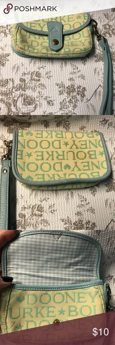 Dooney & Bourke wristlet Dooney & Bourke wristlet light blue writing on tan. Blue trim. Item is used and shows some wear. Spot on back. Can probably be cleaned up easily. Bundle 3 or more to save 10%! Make me an offer!! Dooney & Bourke Bags Clutches & Wristlets