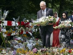 Malaysia Airlines Restructuring Process. This photo shows the Malaysian Prime Minister Naji Razak putting flowers for the MH17 crash victims.