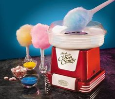 Embrace your inner child with this Nostalgia Electrics cotton candy maker. The unique design turns hard candy or granulated sugar into soft, fluffy cotton candy. Create melt-in-your-mouth treats with this Nostalgia Electrics hard candy cotton candy maker. Cool Kitchen Gadgets, Cool Kitchens, Hammacher Schlemmer, Sugar Free Hard Candy, Sugar Candy, Cotton Candy Cone, Retro Candy, Candy Floss, Geek Gadgets
