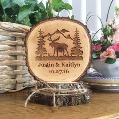 Sweet, rustic wedding cake topper Made from three wood slices Custom engraved with your names and date Double base with twine bow Coating of clear