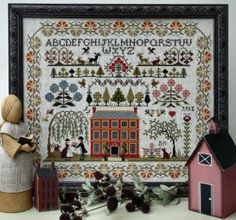 """From The Sampler Company Brenda Keyes is this reproduction sampler cross stitch pattern titled """"Red House Sampler"""" that is stitched with DMC..."""