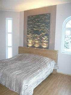 This headboard idea looks like ripples on the stone.  I'm looking for an upscale beach/resort look & with some tweaking this might do.