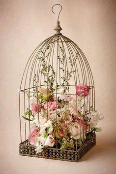 With butterflies...Wedding cake topper idea.