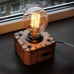 An industrial style wood lamp, a steampunk for retro lamps EDISON. The lamp is made by hand from natural wood, polished and covered with Danish oil. Lampe Steampunk, Lampe Edison, Luminaire Original, Retro Lampe, Deco Luminaire, Handmade Lamps, Wood Lamps, Brass Lamp, Night Lamps