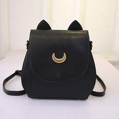 bolso negro con orejas de gato