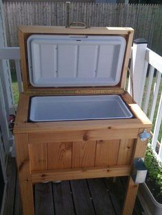 This patio cooler stand is made from cedar decking. 62' to be exact. It holds a 48 quart Igloo cooler. The top is hinged, and the cooler cover is mounted within the top. Bottle opener, and cap catcher complete the case. The cap catcher was made from some scrap tin I had, and assembled with rivets. Its lighter than it looks because of the cedar. This puts your cooler at a perfect height, and comes in handy for BBQ's. (Melanie Ladau Kerwin)