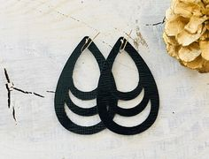 Fancy Black Cutouts made with genuine Saffiano leather. These earrings are on-trend, light weight and fun to wear! Our teardrop leather earring shapes are custom designed and curated by us. They are also each hand trimmed after cutting to clean up the edges to truly create a