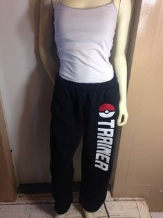 Please allow up to 8(EIGHT) weeks for processing time. If needed by a certain date send me a personal message so we can work something out, thank you. Black sweatpants with a red poke-ball and Trainer on the left leg. Sizes Small through 4XL-Mens Sizes Option of having elastic or no elastic around the bottom hem. (The pants in the photo have elastic in them).