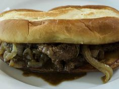 Cube steaks are sliced against the grain into strips and sauteed with onions and Worcestershire sauce. Piled onto French rolls with some of the juice. Delicious. My husband loves them.   I use soy sauce instead of Worcestershire sauce due to our preferences. Recipe from Ree Drummond-Pioneer Woman
