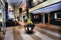 Spacious lobby with a fireplace, TV and music, creating that ambience you expect from The Hilton Garden Inn Bethesda.