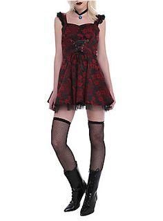 "Black and red brocade dress with black ribbon lace-up detailing and black tulle trim. Side zipper closure.<ul><li> 24"" long from center front</li><li>60% cotton; 37% polyester; 3% elastic</li><li>Wash cold; line dry</li><li>Imported</li><li>Listed in junior sizes</li></ul>"