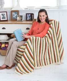 You'll love watching the little flowers appear as you crochet this cozy striped throw. Use the colors we show, or choose from the many Super Saver colors for a new look of your own.