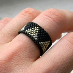 Stylish black ring on middle finger Geometric by HappyBeadwork