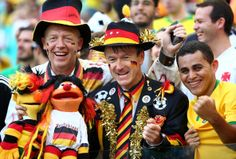 Germany fans soak up the atmosphere during the 2014 FIFA World Cup Brazil Group G match between Germany and Portugal at Arena Fonte Nova on June 16, 2014 in Salvador, Brazil. (Photo by Clive Mason - FIFA/FIFA via Getty Images)