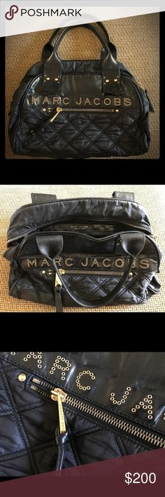 """Authentic Marc Jacobs Quilted Signature Satchel Authentic Marc Jacobs Black Leather/Nylon Quilted Signature Satchel (R06 197) with gold tone hardware, grommet logo at front, top zip closure, single interior pocket, large quilted accents on exterior, and dual handles. This bag is in excellent condition. Ultra chic! 14""""L x 11""""H x 6.5""""W Marc Jacobs Bags"""