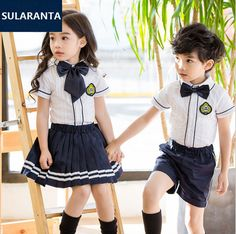 Japanese School Girl Costume Children Girls Boys Cotton British English Student School Uniform Set Shirt Tops Pleat Skirt Shorts Clothes Outfits with Bowknot English School Uniform, School Uniform Images, Best School Uniform, Private School Uniforms, School Uniform Outfits, School Dresses, School Fashion, Kids Fashion, Style École