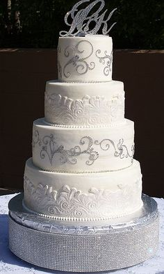 Elegant lace wedding cake with bling swirls