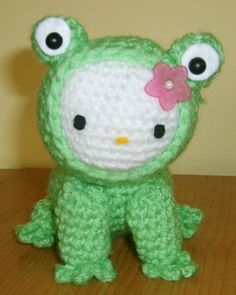 my two fave animals in one amigurumi. cute kitty wearing a froggy costume... or is it froggy juz ate a kitty? o_0