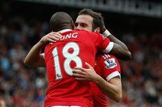 Juan Mata celebrates his goal with Ashley Young.