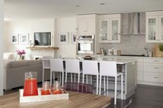 As seen on Love It or List It, Too. homeowners Neena and Jag entertain up to 30 guests at a time so they needed an open space that could accomadate large groups. Designer Jillian Harris created an open concept floor plan by rearranging the kitchen and dining rooms. A large driftwood table in the dining room and an oversized island in the kitchen offer ample seating.