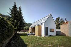 The house is built in Lučatín, a small village in central part of Slovakia. This fragile environment has clearly set the limits and inputs – volume of building, scale, urbanism of village, wood as a material – both structural and visual. There h
