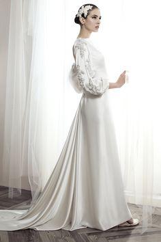 Vestido de novia de la colección Basaldúa alta costura. El detalle de las mangas ¡love it! #vestidosdenovia #weddingdresses #tendenciasdebodas
