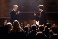 Still of Tom Felton and Daniel Radcliffe in Harry Potter and the Chamber of Secrets