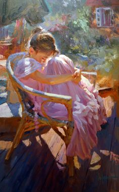 by Vladimir Volegov preteen with long pink dress curled up in chair