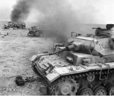 A Panzer command tank of Company , Pz. Division is knocked out along with many burning vehicles in the background, North Africa WWII, pin by Paolo Marzioli