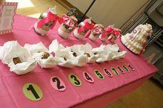 baby shower diaper doodie game, cookie jar prizes, and diaper cake, via Flickr.