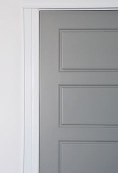 DIY tutorial for getting factory finish gray painted interior doors. PARA Paint's Courtyard was the perfect match for the IKEA Lindigo/Bobdyn gray cabinetry.