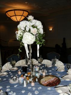 Great hydrangea and blush roses and lilies.  Rose petals on the navy overlay adds to the whole look.