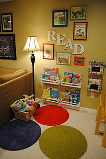 Library area: Low shelves with book covers facing out so kids can see titles. Framed book covers. Small circle rugs. Cute reading nook.