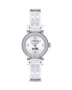 Etched with Signature Cs, glittering with hand-set Swarovski crystals and brilliant in stainless steel, this refined timepiece wears like jewelry. Its shock- and water-resistant design was created exc