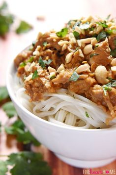 Slow Cooker Thai Chicken with Peanut Sauce ~ features tender chicken stewed in a flavor-infused coconut milk/peanut sauce, served over rice or rice noodles, and garnished with chopped peanuts and cilantro   FiveHeartHome.com
