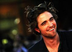 Robert Pattinson, who is reportedly hiding out at Reese Witherspoon's California ranch ever since Kristen Stewart's cheating scandal came to light, was spotted having a good time at a local bar...